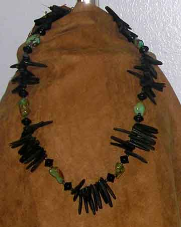 African_sea_urchin_necklace_hanging_on_suede_FINAL_FOR_WEB.jpg (10173 bytes)